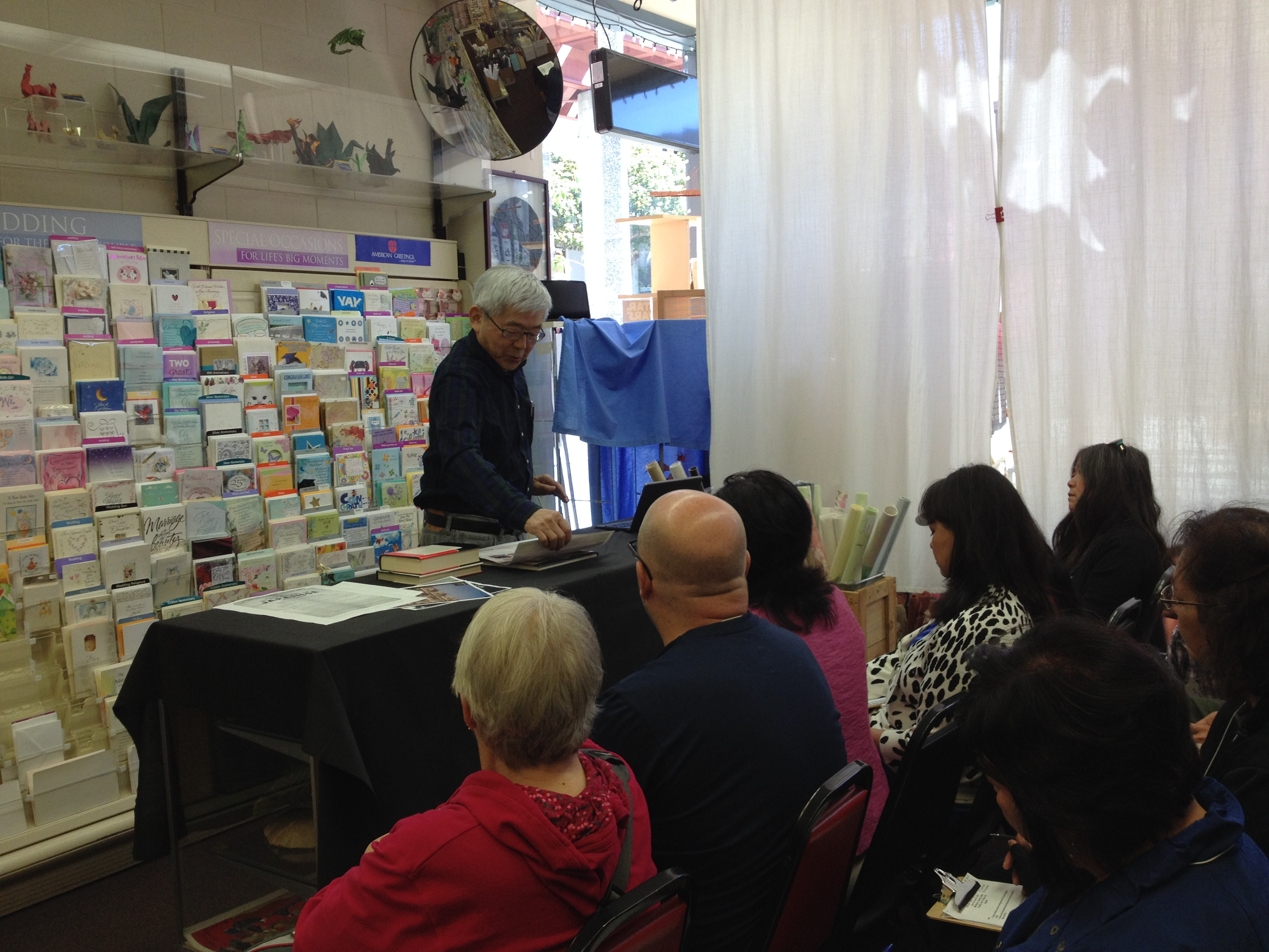 Nob Mihara speaks with teachers in Japantown, San Francisco.