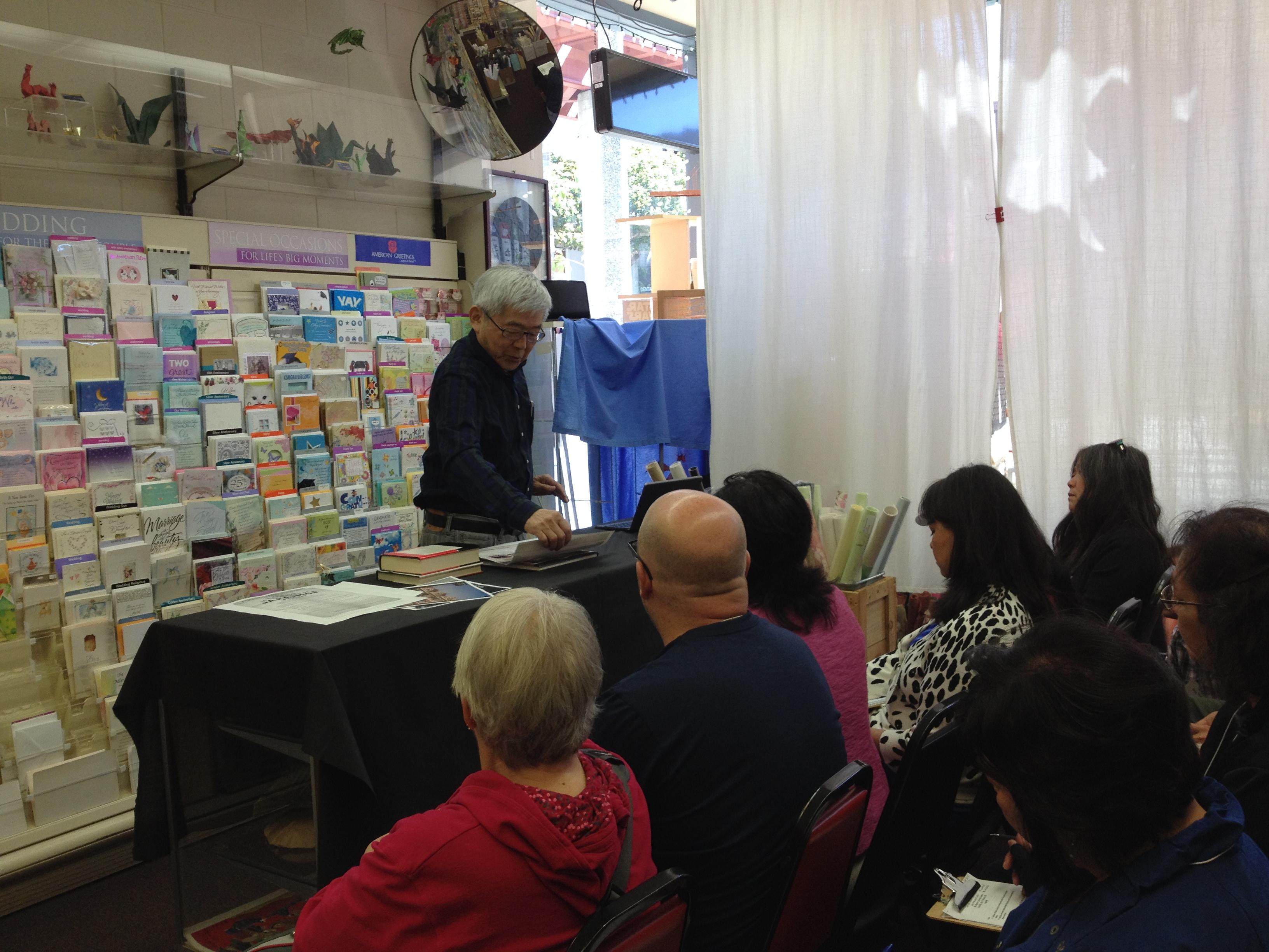 Nob Mihara speaks with teachers in Japantown, San Francisco.