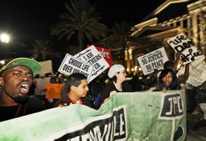 Marchers in Jacksonville, Florida, protest the verdict against Michael Dunn. (Reuters)